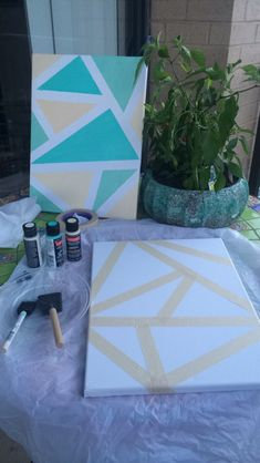 Quick Easy DIY canvas wall decor using masking tape, acrylic paint, and a sponge brush!