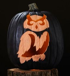 This etched and carved owl looks especially nice on a black pumpkin. Buy a black foam pumpkin or spray-paint a real pumpkin.