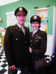 Attendees in full, military, retro attire visiting The Kenwood Kitchen Theatre at Goodwood Revival 2015 ©Come Step Back In Time.