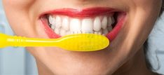 Natural Teeth Whitening Remedies Whiten your teeth - Dr. Axe - Learn the secrets to whiten your teeth naturally using coconut oil, baking soda, lemon peels and other natural health remedies. Teeth Whitening Remedies, Teeth Whitening System, Natural Teeth Whitening, Activated Charcoal Teeth Whitening, Teeth Implants, Dental Implants, White Teeth, Dr Axe, Dental Health