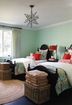This room has great green mint tones mixed with pops of bright red. Really playful color pallet and wonderful mix of textures and pillows.