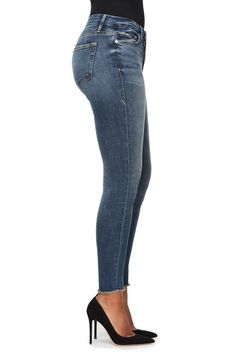 Skinny jean. High rise. Slimming silhouette. Medium wash denim. Raw edge hem detailing. 29 inch inseam. Made in Los Angeles with imported materials. 93% Cotton | 5% Polyester | 2% Elastane