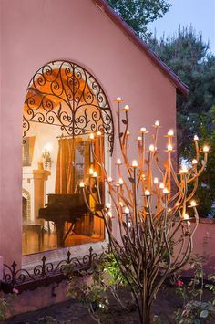 Garden sculpture with candles in the garden of Clark Gable and Carole Lombard's Palm Springs Home