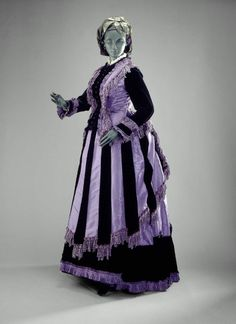 Day dress, silk taffeta and velvet trimmed with fringe and ruchings of self-fabric, 1870, American.