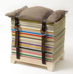 "Storage: Hockenheimer Magazine and Newspaper Stool:  designers came up with a clever idea for putting your magazine stacks to use with the Hockenheimer, a ""sustainable and personalized piece of furniture."" The Hockenheimer (which comes in two sizes) is handcrafted by local artisans and features a wooden birch stand, leather straps (also available in red nylon), a hand-sewn pillow, and custom buckles and rivets. Both the Hockenheimer Magazine and Newspaper stools are available online through…"