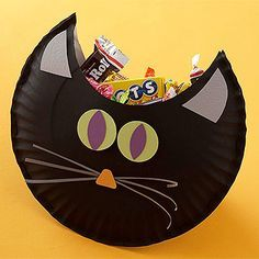 Kids will have a blast creating these Black Cat Treat Pouches during the Halloween party, and they'll love them even more when they get to fill them with candy and take them home!