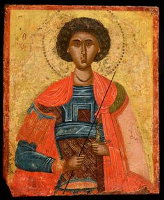 St George III. Northern Greece or Macedonia Late 16th century. St George is portrayed half-length, in military attire against a gold background. He holds a spear diagonally in his right hand and a sword in its scabbard in his left. His shield which almost conceals his left arm is decorated with a stylized Medusa head. The saints' breastplate is decorated with intersecting blue bands and with chrysography in short parallel gold lines.