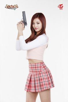 TWICE members with guns? The combination couldn't work any better.Not to be alarmed, folks, because it's not like the girls were toting actual firearm…