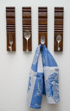 DONE: diy utensil hooks - hung my vintage thrift store hand beater on one one I made from an old fork.  Looks cute!
