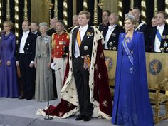 Queen Maxima looks so royal, next to her husband, in her beautiful dress, really pretty.