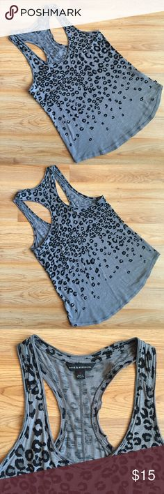 """Rock & Republic cheetah print racerback tank EUC Rock & Republic cheetah animal print racerback tank top in gray and black. Size small. Runs large. Pit to pit is 17"""". Shoulder to hem is 28"""" in back and 27"""" in front. Hem opening is 20"""". Excellent used condition. No trades or holds. Please use offer button to make an offer. Rock & Republic Tops Tank Tops"""