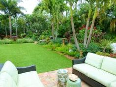 My husband, Jim and I designed this space and added all the plants, including the Palms, Bamboo, Mango Tree, Tropical Wisteria, Dombeya, Crotons, Bromeliads,  Brunfelsia ... See Moreand many more. See Less