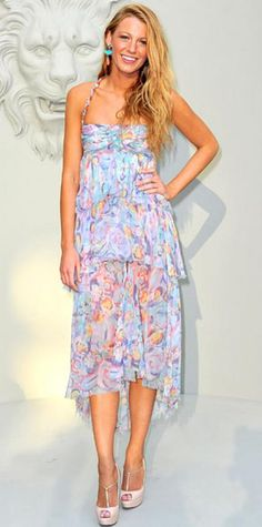 Look of the Day › July 7, 2010 WHAT SHE WORE The Gossip Girl actress attended the Chanel haute couture show in a tiered print dress from the design house's spring collection paired with Louboutin T-straps. WHY WE LOVE IT Blake Lively looked boho-sexy in a sheer '20s-inspired design. She gave her flowing Parisian dress a Cali girl spin with loose beachy locks and bright statement earrings.