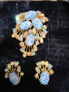 """Highly collectable early Schiaparelli's set. Incomparable fantasy, unique style and perfect taste put Elsa Schiaparelli. Brooch looks like new, perfect condition. Clips have some wear of metal. Size of brooch -3 1/8"""" x 2"""". 