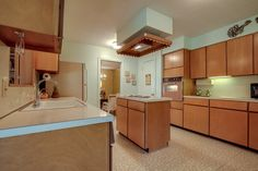 My mid-century (1962) home: Before- View of the kitchen from the breakfast area.