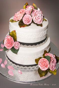 Elegant butter cream wedding cake with flowers.