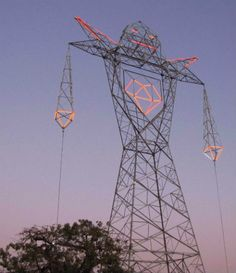 A massive power line tower in Buenos Aires, Argentina now has a glowing face, hands, shoulder spikes and heart thanks to a daring installation by Argentinean art collective DOMA. Known as Colossus, this urban intervention is 45 meters (almost 148 feet) tall. Best of all – the neon is animated. #futuretrips
