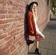 orange coat • black heeled boots • white cute dress • black brim hat • hipster •