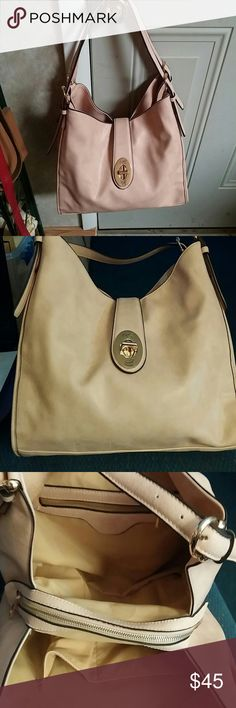 Carolyn Tucker Handbag Beautiful blush pink bag.  Latch closure.  Center zipper plus pocket and holders on the inside.  11x14x5.  One small mark on the bottom (shown in picture 4) otherwise in excellent condition.  Never used.  Straps are adjustable. Carolyn Tucker Bags Shoulder Bags