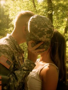 Mwaaa!!! :) Country first Army engagment bride wedding kiss flag stars and stripes partiotic deployment love military acu fist 13fox soldier homecoming stealing his last name lee heart