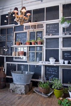 Old windows painted with chalkboard paint, this is amazing.  Would be perfect for a wall in a finished basement or game room.