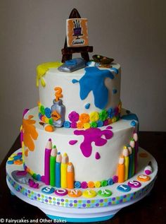 A cake made for an art themed party. Covered in buttercream with fondant accents and decorations!