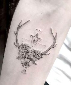 Deer's antlers and flowers on the forearm. Style: Fine Line. Color: Black. Tags: Cool, Nice, Beautiful