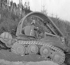 Logging road construction using early bulldozer :: MacMillan Bloedel Limited fonds