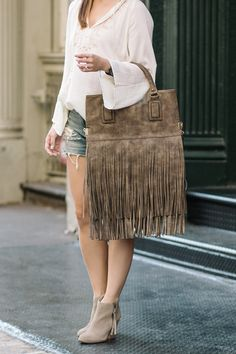 """Make a statement this fall with Sole Society""""s Sonora fringe tote."""