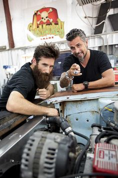 Aaron Kaufman, left, and Richard Rawlings pose for a portrait June 5, 2012, at the Gas Monkey Garage in Dallas. Kaufman says his beard has gotten caught in equipment -- and occasionally caught on fire -- while he's working. (Special to DFW.com/Andrew Buckley)
