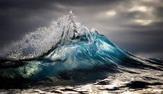Photographer Ray Collins swims out to sea each day, capturing stunning photos of surging waves that seem frozen in time. #photography #nature