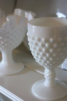 milk glass displayed on a mantel is beautiful...put a small votive in each.. the lighting is gorgeous
