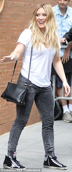 Cool kicks: The blonde beauty sported black high-top sneakers printed with stars...