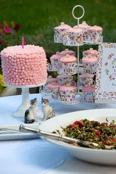 Cake for birthday girl. Cupcakes for guests. Love the easy cake decor!