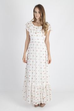 Vintage 70s boho wedding hippie maxi dress.  Tailored empire bodice with lace ruffled trim.  Gathered and fitted waist with slim draped skirt.  Thin white cherry floral cotton blend material.  Dress is lined and zips up the back.     size estimate: M shoulders: draped bust: 34 waist: 26 hips: 34 total length: 60    Model is 510 and measures 32 bust, 25 waist, 36 hips Belts and other accessories are not included.