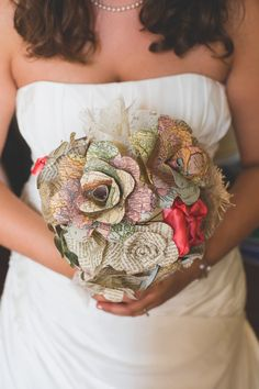 This gorgeous map bouquet by CraftingByKnight via etsy is perfect for a travel theme wedding. #alternativebouquets #paperflowers