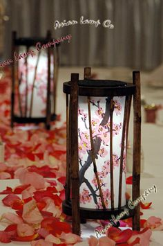 Cherry Blossoms are some of our most popular designs. They are available in either a red or pink hue. Available for all sizes of centerpieces. Shown here are round cherry blossom centerpieces. For round centerpieces, a battery light hangs inside of it upside down and the electrical cords are pre-installed for home use.