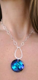 Swarovski Bermuda Blue twist coin pendant with Sterling Silver accents and chain