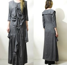 "☩ AVANT GARDE MAXI DRESS 90s vintage dress Bondage / straight jacket style tie-up front Gathering, pintucks and draping Sailor bib across back 3/4 length sleeves Long maxi length Dark grey with fine variegated marl Woven fabric  Label: Modern Collection Size on tag: - Best fit: XS-S Fabric: Unsure, woven.. feels like cotton/poly blend Condition: Excellent  ☩ M E A S U R E M E N T S Length: 140cm (55"") Bust: 46cm (18) Waist: 43cm (17"") Hips: 53cm (21"") Sleeve: 41cm (16"") *Measur..."