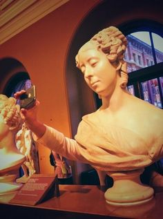 This woman who should know this isn't a flattering selfie angle. | 20 People Who Forgot How To Behave In Museums