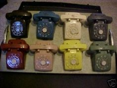 """Salesman's sample case of miniature vintage telephones.  Each phone is 2"""" x 4"""" and the handsets lift ."""