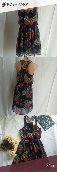 Eyeshadow Multicolored summer dress medium Brand: Eyeshadow Size: medium Pit to pit: 17 inches Top to waist: 16 inches Length: 35 inches  Slight high low, about an inch at the bottom. Multicolored. Used once. Racer back top. Black lining. Eyeshadow Dresses High Low