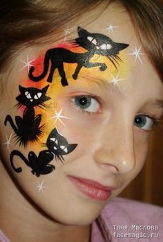 Black cats. Face paint by Tanya Maslova.