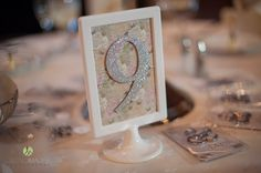 Glittery and floral table numbers | Lasting Images Photography | villasiena.cc