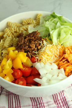 Doritos Locos Taco Pasta Salad Taco Salad Recipes, Taco Salads, Cucumber Recipes, Lemon Recipes, Mexican Food Recipes, Ethnic Recipes, Copycat Recipes, Mexican Chicken Casserole, Taco Ingredients