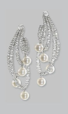 A PAIR OF CULTURED PEARL AND DIAMOND EAR PENDANTS Each designed as four brilliant and baguette-cut diamond hoops of varying length suspending a cultured pearl