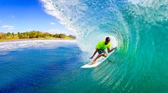 """To avoid a harsh winter in the Northeast, Trevor Murphy traveled to Costa Rica on a surf exploration trip. """"Clear warm water with a nice offshore breeze warms up the cold northeast bones,"""" he writes. He shot this photo with a 15 mm fish-eye lens. Costa Rica, Villas, Best Honeymoon Destinations, Romantic Honeymoon, Beautiful Places To Travel, Amazing Adventures, Ocean Waves, Central America, Places To See"""