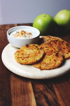[Leaf Parade. Creole Oven-Fried Green Tomatoes with a Greek Yogurt Ranch Sauce.]