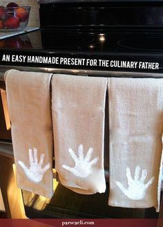 Make these DIY Homemade Handprint Towels for a dad who loves to cook!