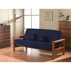 I like this kind of futon frame because of the storage on the ends - perfect for remotes, books, etc.